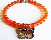 Butterfly Charm and Orange Glass Beads Bracelet