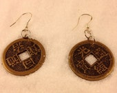 "Earrings, ""Temple Dreams"" are earrings made from Tibetan coin replicas."