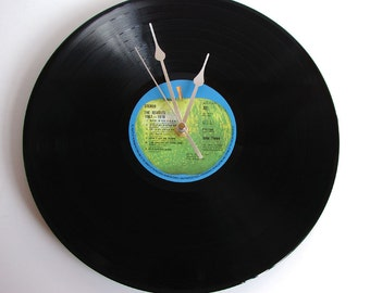 """The Beatles Vinyl Record CLOCK made from an Original recycled 12"""" LP. Comes in a box. Made in the UK by Vinyl Time."""