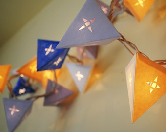 Hanging Paper Star Lights - THE CHILDLIKE EMPRESS - handmade paper lanterns in purple, cream, and blue with geometric die cuts