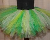 Green, Lime, and Cream with Gold sparkles all packaged nicely in a tutu
