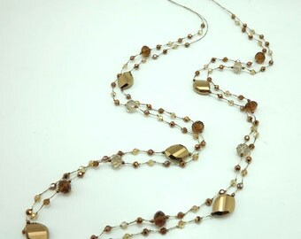 Gold and topaz crystal hand-knotted on silk thread necklace.