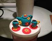 Teapot and teacup set with saucers