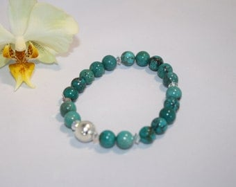 Turquoise beaded  Bracelet with swarovski crystals and sterling  silver bead.