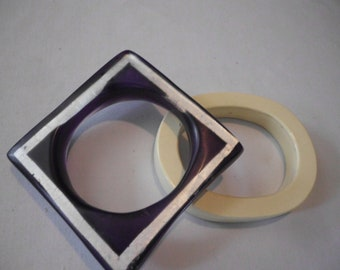 MOD Two Bracelets one Purple Lucite one Ivory Plastic1970s