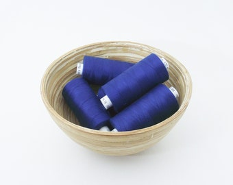 Mid blue polyester sewing thread. Coats Moon colour M0001. 1 reel