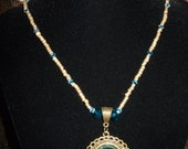 Gold and Turquoise beaded necklace with pendant