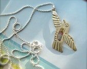 Long chain, Bird pendant Necklace, with wind in its wings. Peace dove.