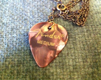 brown Fender guitar pick necklace