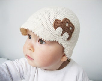 Cream-colored hat with a machine application. Baby boy cap. Crochet hat for baby boy. Creamy cotton crochet cap for summer boy. Visor hat.