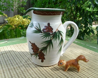Specialties Stonewear Beverage Pitcher-Pinecones And Pine Branches