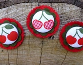 Cute cherry fabric covered buttons layered onto felt