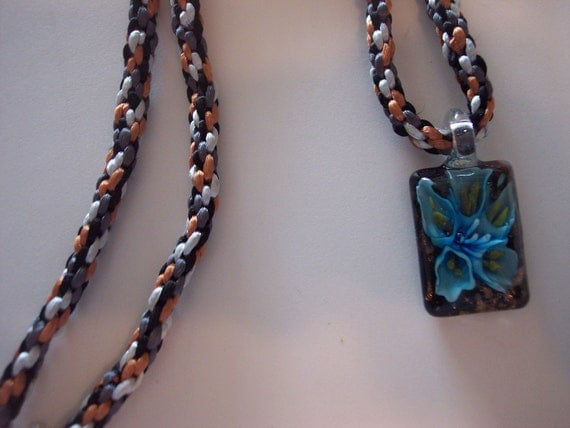Kumihimo in blues and browns braided necklace with glass flower pendant