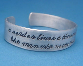 A Reader Lives A Thousand Lives... - A Hand Stamped Aluminum Bracelet