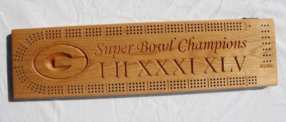 Green Bay Packer Super Bowl Champions cribbage board made from solid Oak