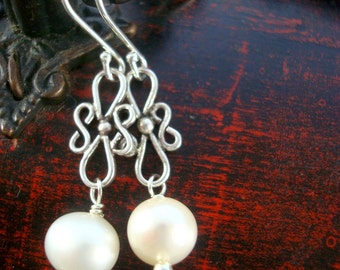 Sterling silver infinity link and white pearl earrings by Cerise Jewelry