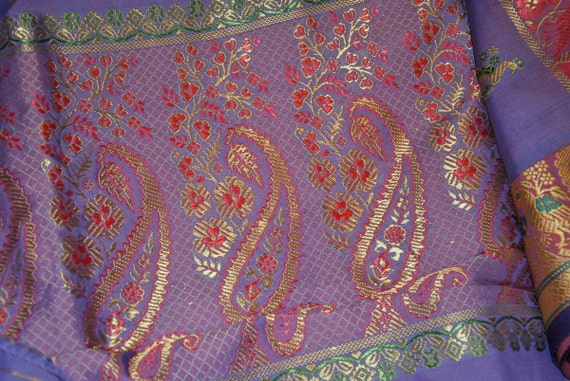 This is what I consider the quintessential Indian sari with its orange and purple mix and that great end piece