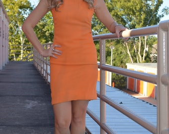 Orange cocktail knee length dress with beaded neckline