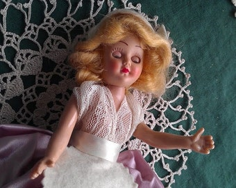 Dutch Vintage doll with pink/purple dress
