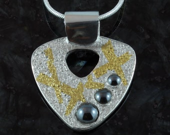 Gold and silver with hematite pendant
