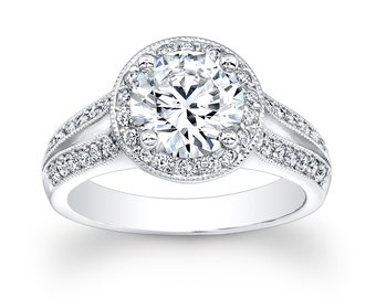 Ladies 14kt white gold engagement ring with split band and round diamond halo with 2ct natural white sapphire and 0.80 ctw G-VS2 diamonds