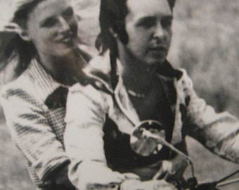 1970's 8x10 black and white candid photograh of Paul and Linda McCartney on a motorcycle