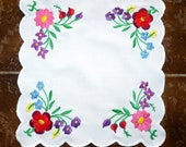 Little square table cloth decoration with handmade embroidery