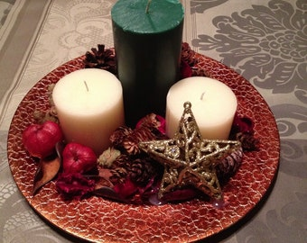 Holiday table centerpiece on 12 inch metallic plate