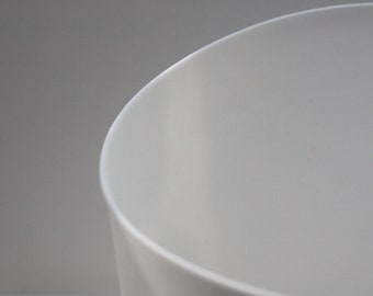 White vase with an unusual design from fine bone china