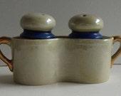 Vintage Japanese lustreware salt and pepper shaker in gilt handle holder.