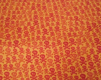 SALE One Yard Orange Skull and Crossbones Fabric - Gone Haunting - Sue Zipkin