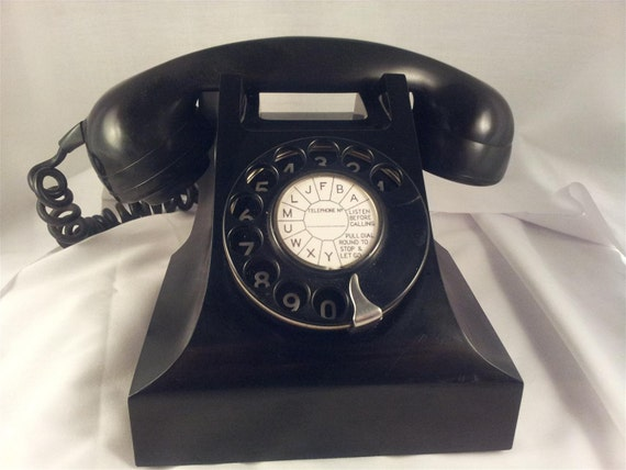 Black Bakelite 400 rotary telephone from the 1950s.