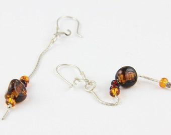 Handmade sterling silver pair of dangle earrings with amber stones
