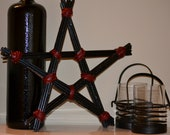 Decorative Star made of Black Glittery Willow Branches and Red Leather