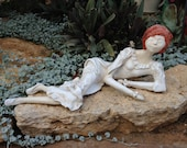 A Recycled Paper Mache Sculpture.  An applique sculpture made of recycled paper.  It's a recycled art piece.