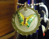 Bottle cap pendant with multicolor metal butterfly set in resin.