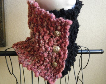 Chunky, black and pink knit cowl with silver thread accent and silver tone buttons.
