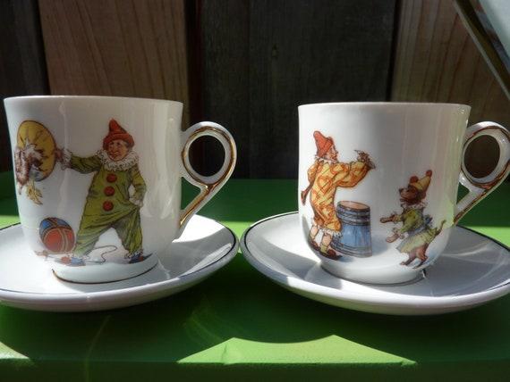 2 Miniature Clown Teacups with Saucers