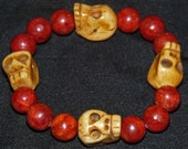 Carved ox bone and red coral bracelet