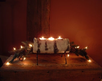 Single yule  log cradle with birch log and prelit evergreen boughs