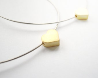 Circle silver earrings with tiny gold heart bead