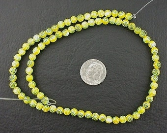 5mm yellow / lime / green flower glass beads