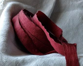 50 yard roll of pretty crinkled burgundy ribbon