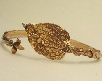 statement leaf bracelet large leaf bangle bronze twig branch botanical jewelry nature jewelry