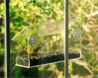 Window Feeder by Peters Feeders: Brings the birds up close for great bird watching fun.