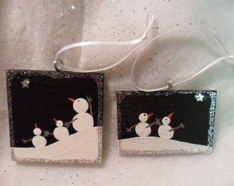 Snowmen ornaments. Set of two handpainted wood ornaments. Snow couple, and snow family. Silver glitter.