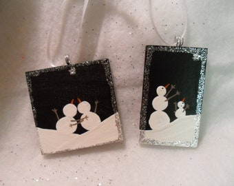 Snowmen ornaments. Set of two handpainted wood ornaments. Snow couple, and snow adult and child. Silver glitter.