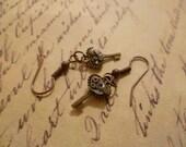 Steampunk key earrings. Vintage watch cogs and gears.