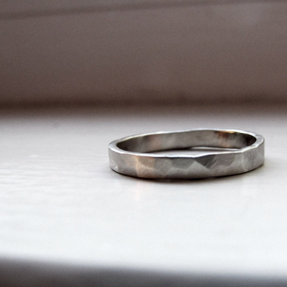 simple ring primitive style white gold wedding band