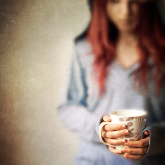 On A Rainy Day Conceptual Photograph. red hair girl blue hood, tea coffee cup, warm, cozy